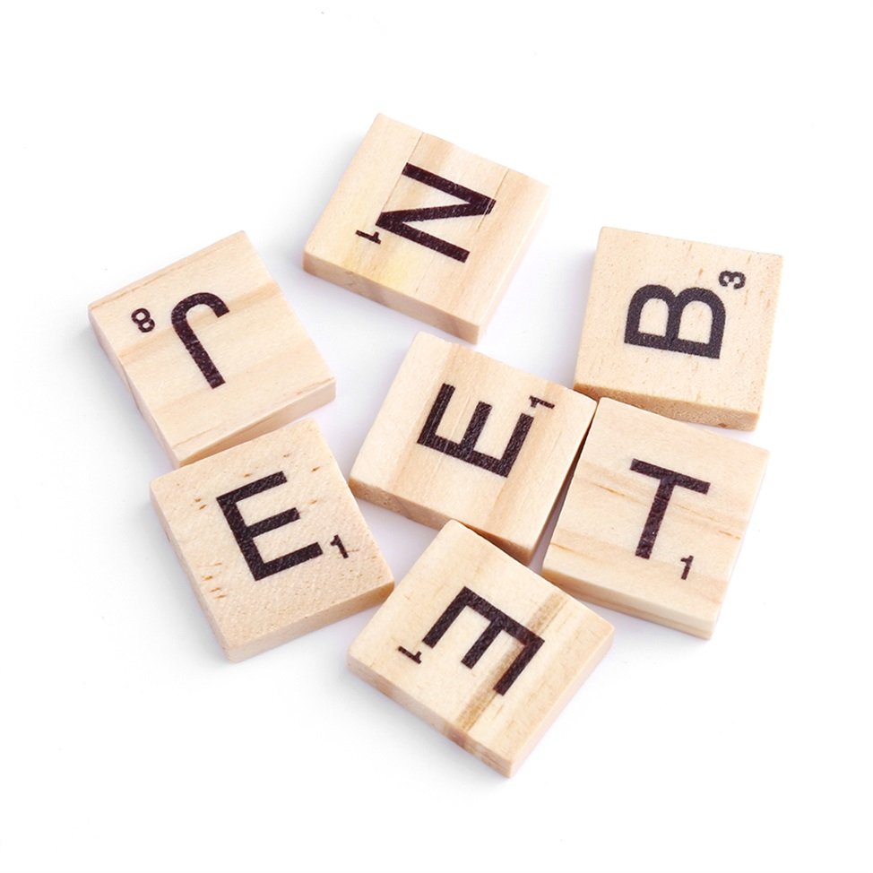 set of wooden scrabble letter tiles black letters with letter ...